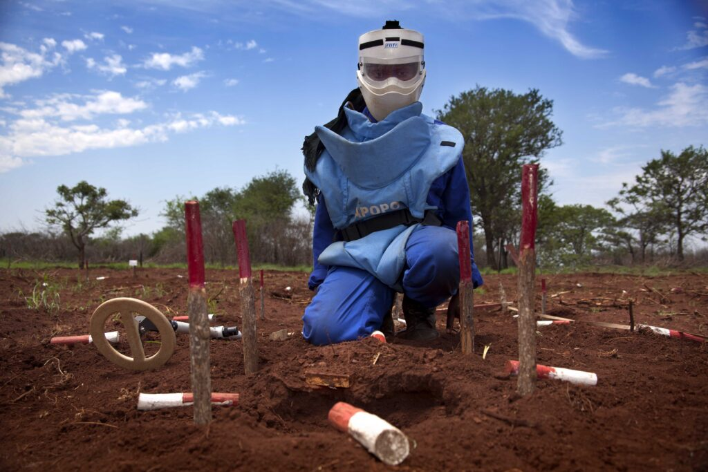 An APOPO deminer excavates a landmine in Mozambique. APOPO cleared minefields on the border with Zimbabwe, helping the Government of Mozambique declare itself mine-free in 2015. (Photo courtesy of APOPO)