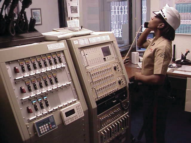 A Marine Security Guard takes a phone call at Post 1, circa 1980s. [U.S. Department of State photo]
