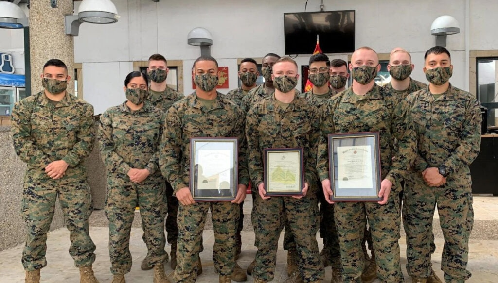 The U.S. Embassy Bogota's Marine Security Guard Detachment wear masks to a ceremony where three Marine Security Guards received meritorious promotions, on June 2, 2020. (U.S. Department of State photo)