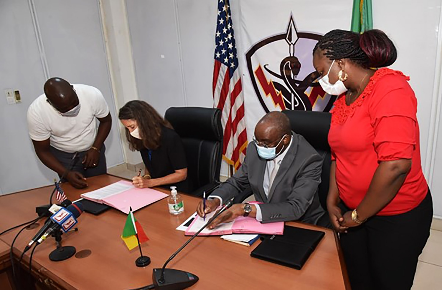 U.S. Ambassador to the Republic of Benin Patricia Mahoney(Second from left) and Benin's Minister of Interior Sacca Lafia(third from left) sign a letter of agreement formally establishing West Africa's non-high threat Special Program for Embassy Augmentation and Response (SPEAR) team, Cotonou, Benin October 1, 2020. (U.S. Department of State photo)