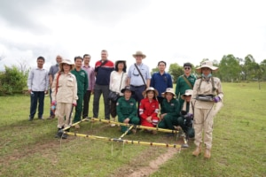 Ambassador Haymond meets with a MAG technical survey team in Xieng Khouang Province, Lao PDR. (Photo courtesy of U.S. Embassy Vientiane)