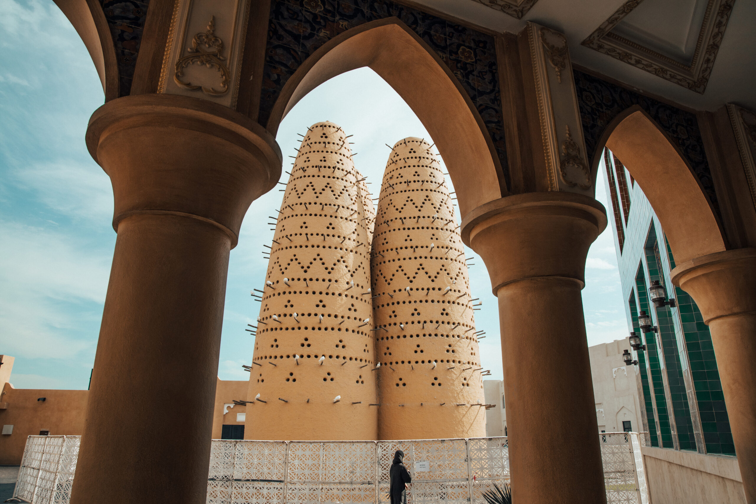 Pigeon towers of the Katara cultural village in Doha,Qatar framed through an arch. Katara is located on the eastern coast between West Bay District and the Pearl-Qatar [Shutterstock]