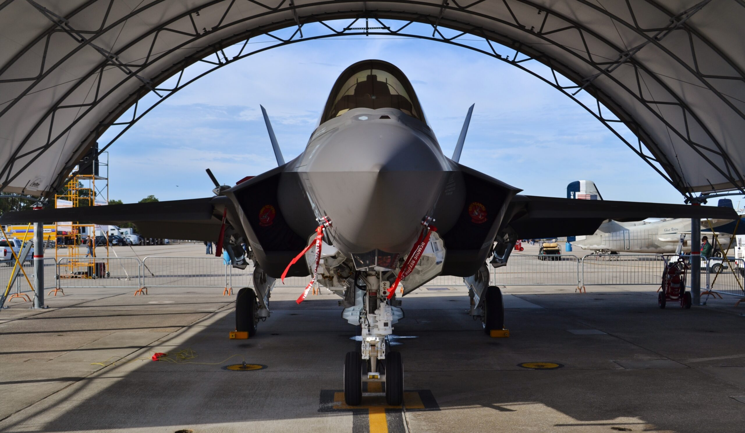 Pensacola, FL, USA - November 11, 2016: A U.S. Air Force F-35 Joint Strike Fighter (Lightning II) jet in a hangar. This F-35 is assigned to the 33rd Fighter Wing at Eglin Air Force Base. [Shutterstock]