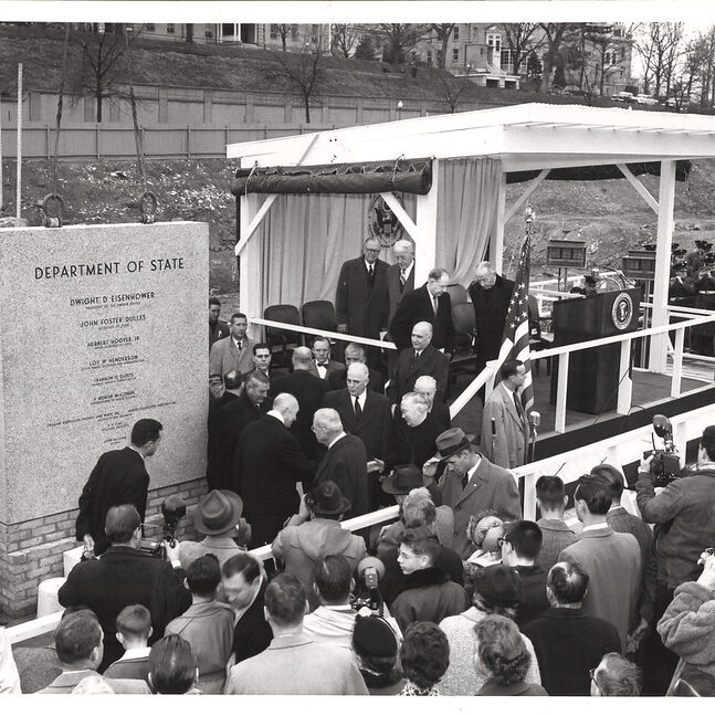 President Eisenhower and Secretary of State John Foster Dulles at the laying of the cornerstone for the New State Building. Pictured near President Eisenhower are Chief Justice Earl Warren (center) and Ambassador Loy Henderson (far right), January 5, 1957. Photo credit: State Dept.