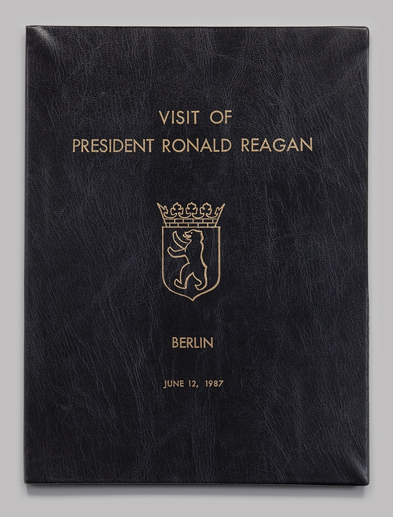 Photo showing the program folder from President Ronald Reagan's June 1987 visit to Berlin. [Department of State]
