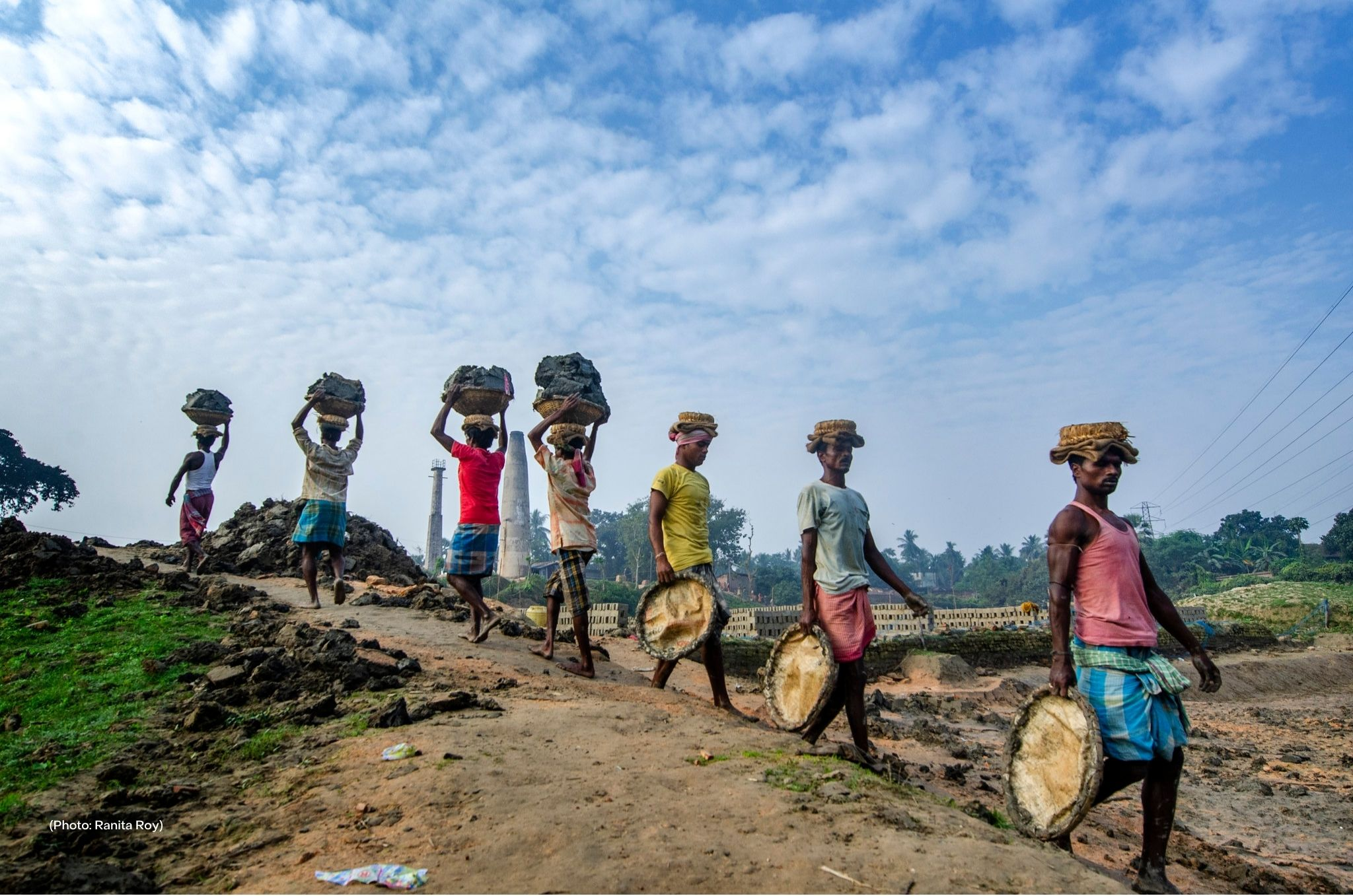 Indian men carry clay and materials to and from a brick kiln. Across India, traffickers force entire families to work to pay off debts, also known as debt bondage. Conditions at brick kilns are extreme; workers often do not have running water and endure excruciating temperatures at sites filled with dust and dangerous chemicals.