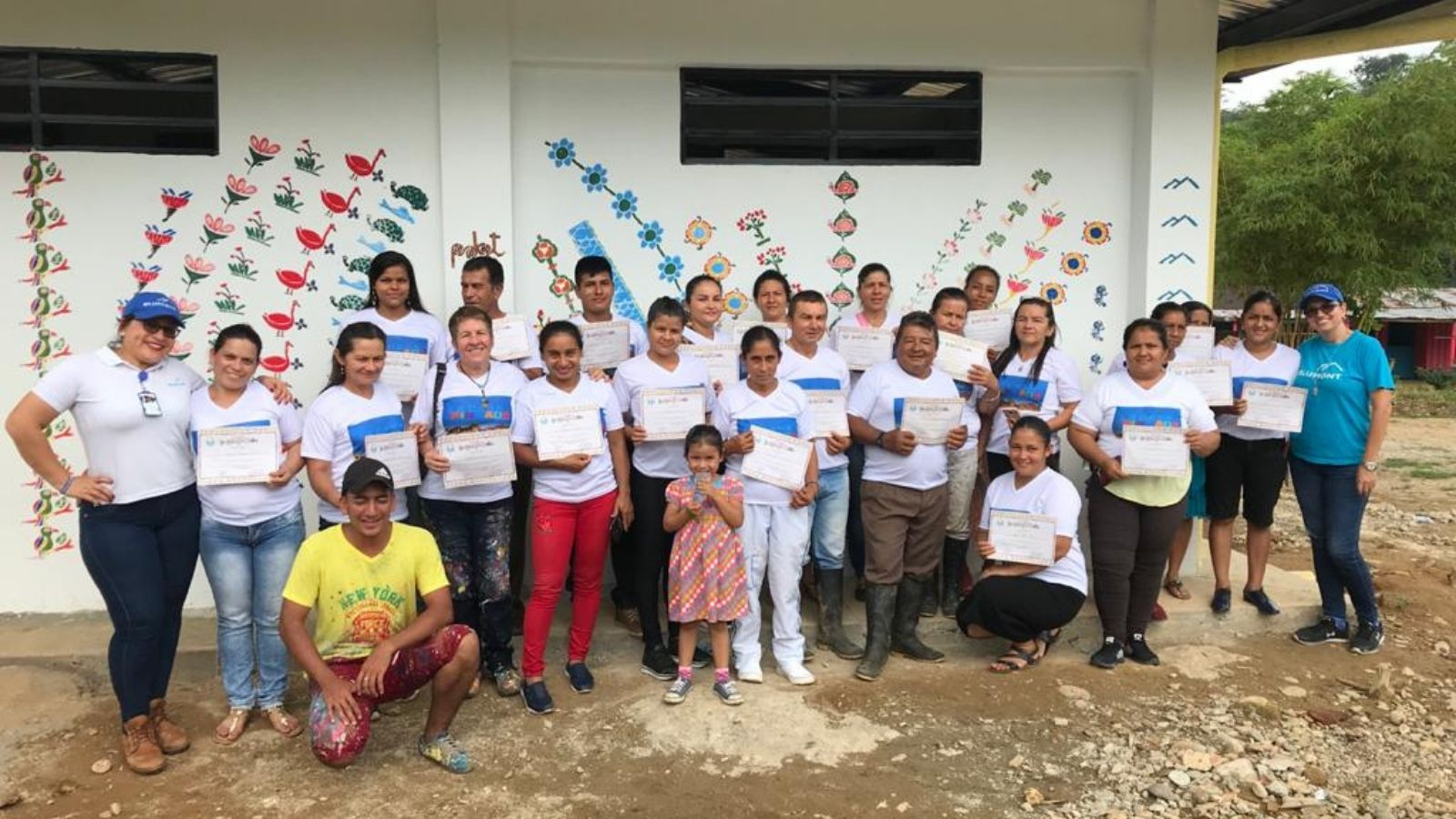 Program participants from San Antonio, Cordoba, hold certificates after participating in the Casa Pintada program.