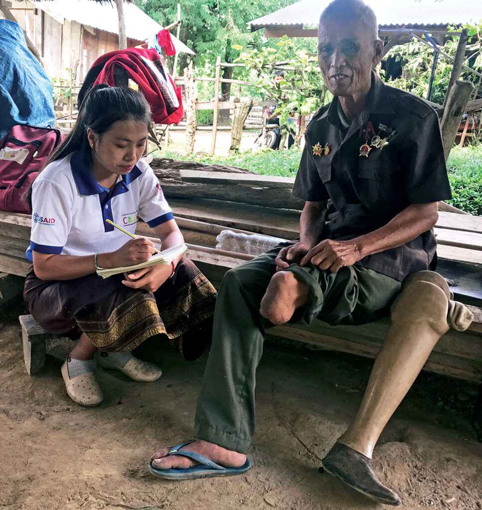 Mr. Thongin is fitted for his prosthetic leg. [Photo courtesy of World Education/OKARD]