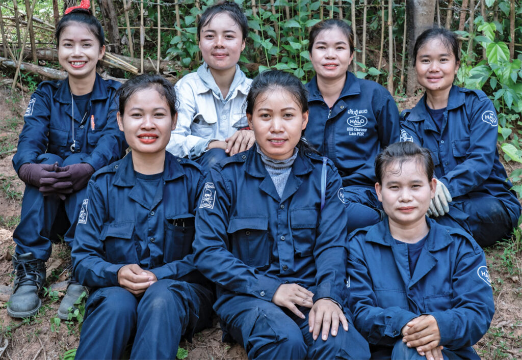 Malayathong Khodsisa (in light-colored shirt) and a HALO training team in Laos comprised of women. [Photo courtesy of HALO]