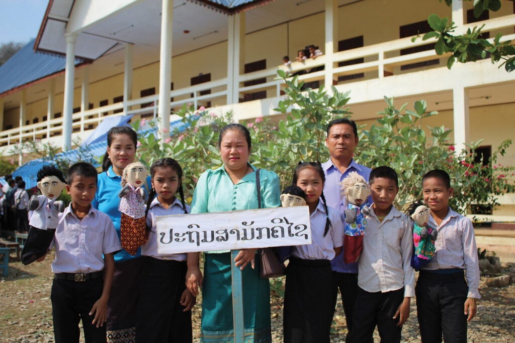 World Education, Inc. uses puppets in its EORE curriculum in primary schools in Laos. [Photo courtesy of World Education, Inc.]