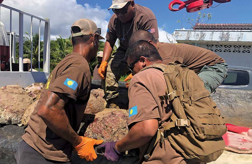 UXO cleared from the waters near Palau is loaded for transport to a safe location for destruction. [Photo courtesy of NPA]