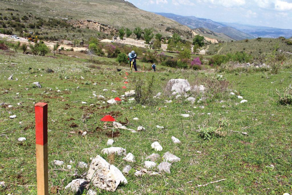 Work progressed at Sinanaj, Albania during completion of UXO hotspot clearance. [Photo courtesy of NPA and ITF]