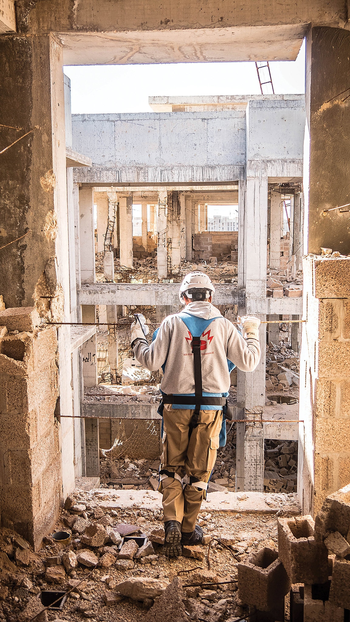 An EOD searcher views destruction in downtown Benghazi, Libya. [Photo courtesy of DCA]