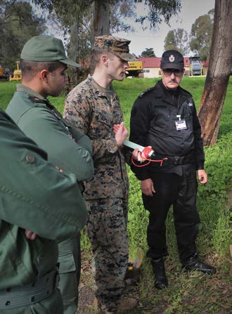 USAFRICOM and Moroccan Royal Armed Forces discuss training methods. [Photo courtesy of USAFRICOM]