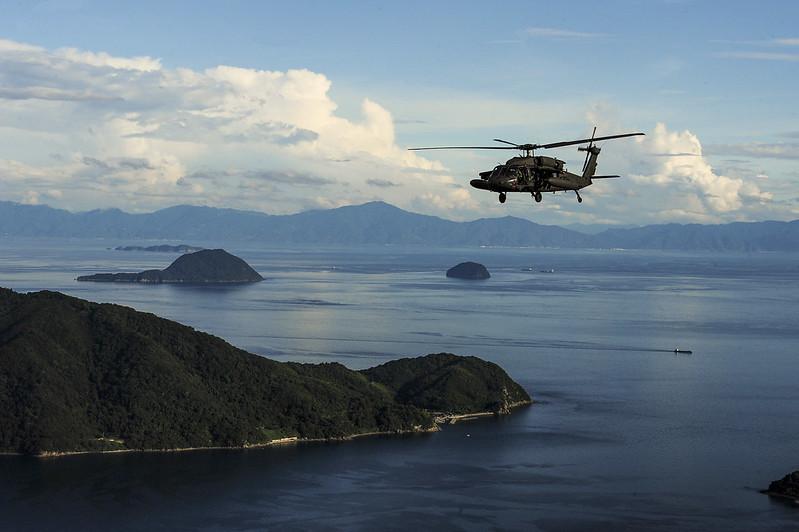 U.S. Army UH-60 Blackhawk flies in formation over Yamaguchi Bay, Japan