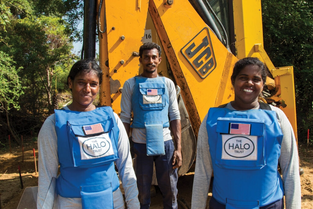 A mechanical clearance team in Sri Lanka takes a break from work on the Mulhamalai minefield. [Photo courtesy of HALO]