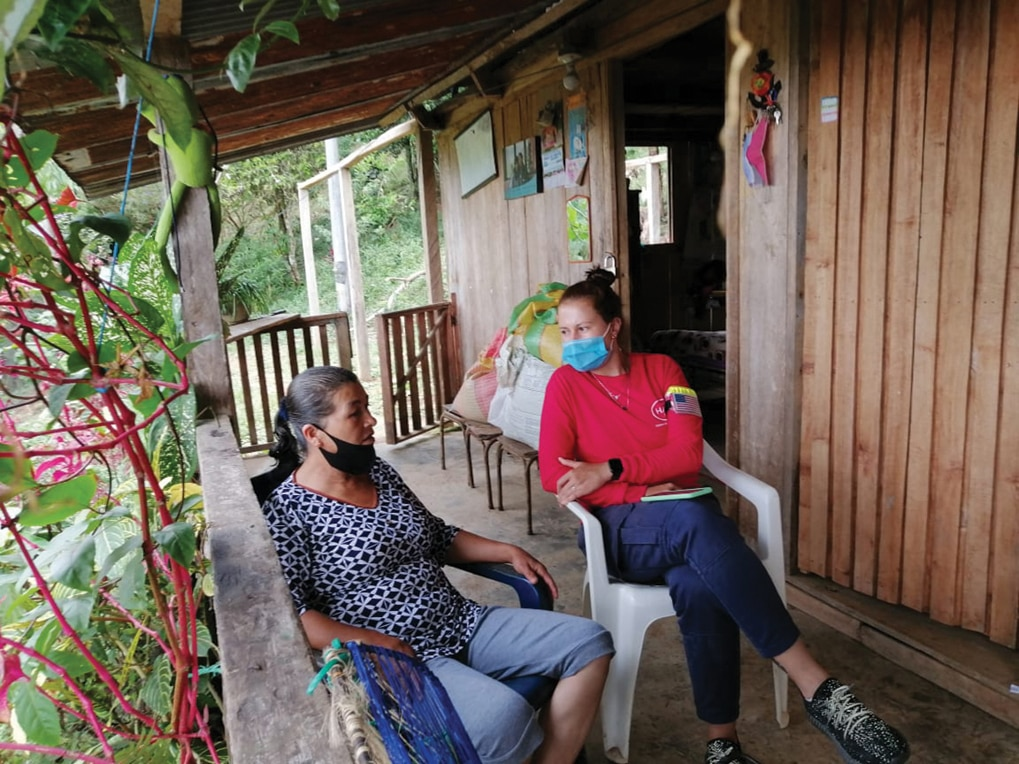 Andrea Garcia (right) talks with a local resident while conducting an NTS in San Juan de Arama, Colombia. [Story and photo courtesy of HALO]