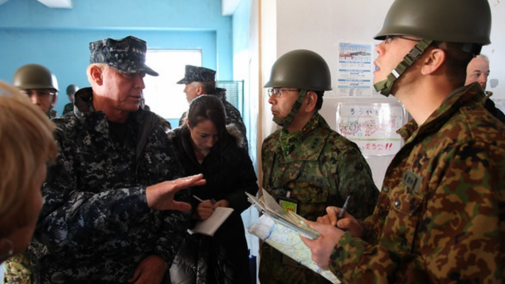 Former U.S. Pacific Command (PACOM, now INDOPACOM) Commander Admiral Robert F. Willard discusses relief efforts with Japan Self-Defense Forces leaders in Sendai, Japan, on March 23, 2011. [State Department photo/ Public Domain]