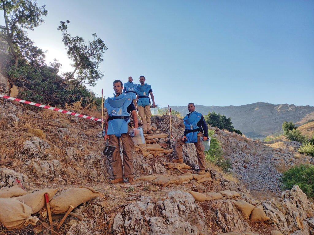 A manual clearance team pauses work in Batroun District Lebanon. (Photo courtesy of Humanity and Inclusion)
