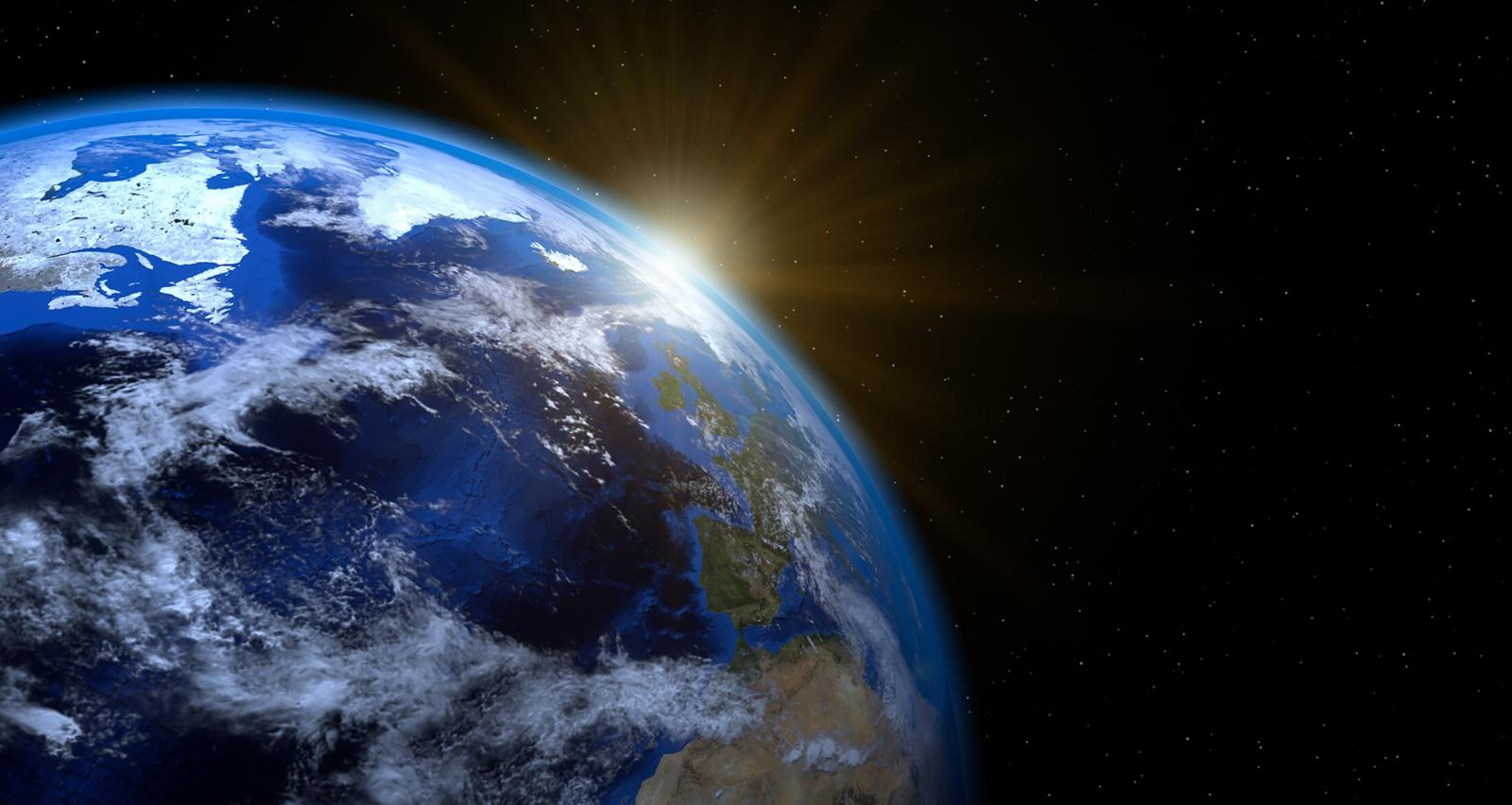 Earth With Sun Rising In Horizon