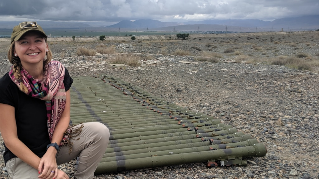 Aimee Falkun, the Strategic Advisor with the PM Bureau's Office of Weapons Removal and Abatement, inspects MANPADS tubes set out for destruction, Kyrgyz Republic, 2019. (State Department photo)