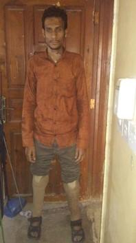 Abdulrahman posing with his prosthetics. (Photo Courtesy of the Marshall Legacy Institute)