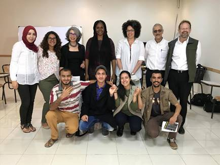 Author Christopher Merrill poses with a group that is participating in a Lines and Spaces Creative Writing Workshop program in Morocco. (Photo courtesy of the International Writers Program)