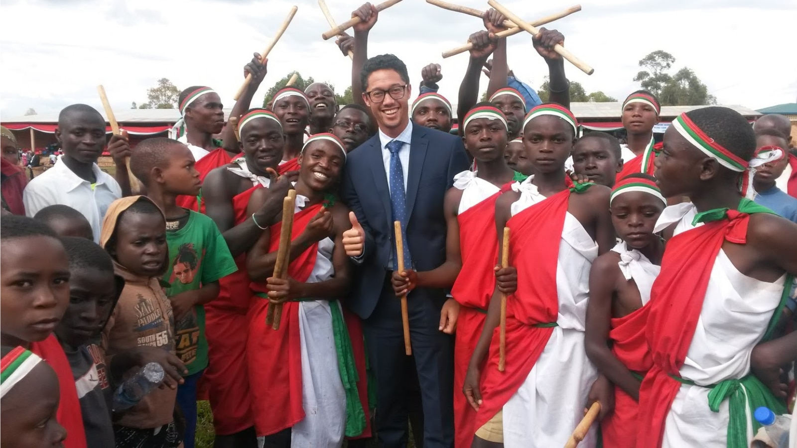 Author Bryan Kenji Schell poses with members of the local community in Gitega, Burundi. (Photo courtesy of the author)