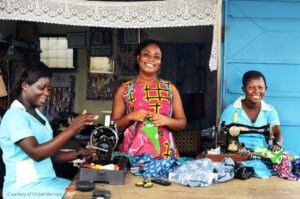 Three women sewing