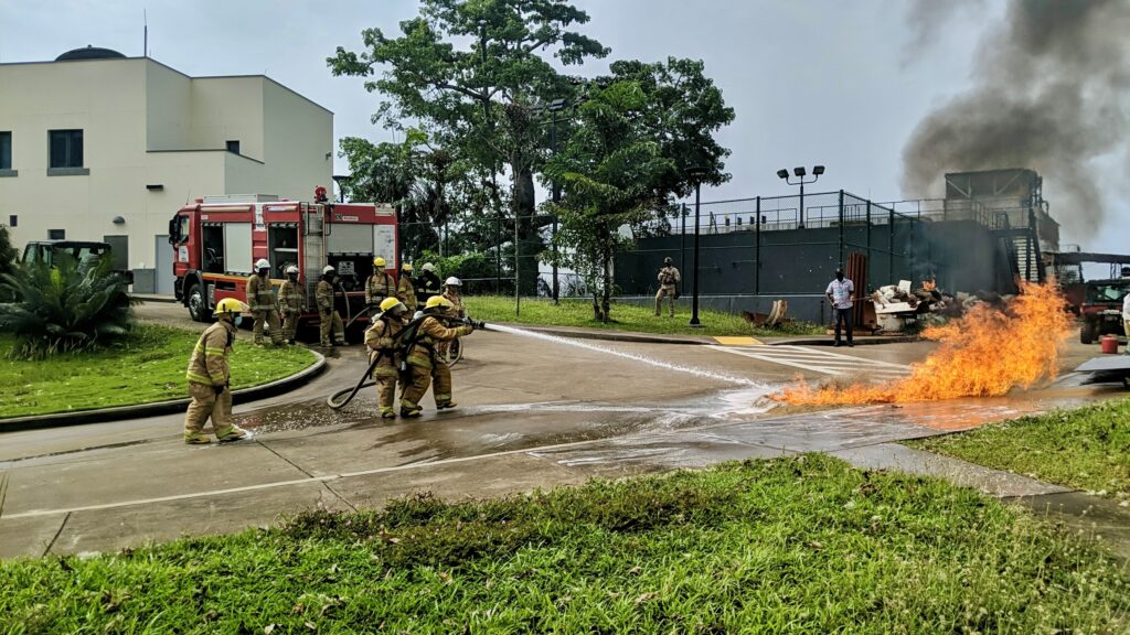 The Liberia Fire Service extinguishes a fire on the U.S. Embassy Monrovia compound during a fire drill, Monrovia, Liberia, March 2021. (U.S. Department of State photo)