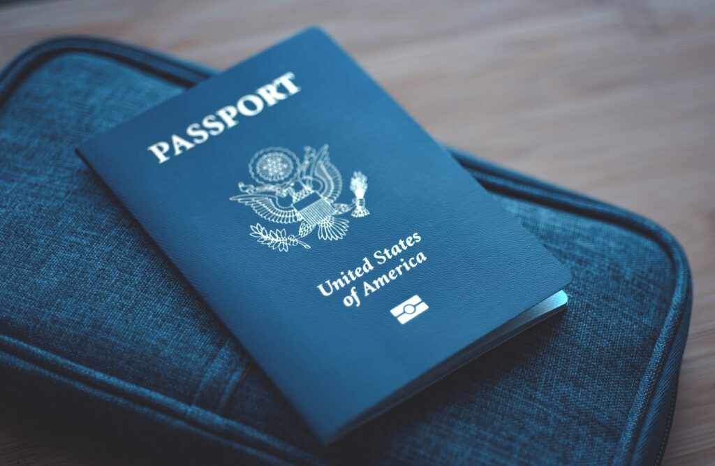 Passport,Of,Usa,(united,States,Of,America),On,Blue,Travel