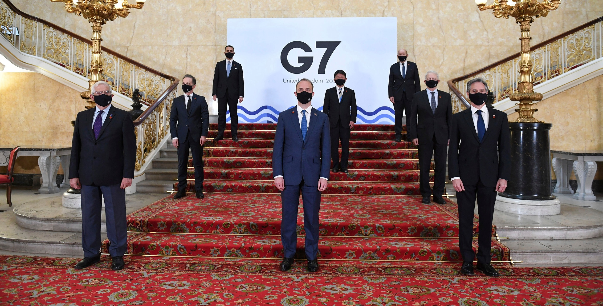 G7 foreign ministers wear face masks and are socially distanced for a group photo, with front row from left, European High Representative of the Union for Foreign Affairs Josep Borrell, British Foreign Secretary Dominic Raab, U.S. Secretary of State Antony Blinken, middle row left to right, German Federal Minister for Foreign Affairs Heiko Maas, Japanese Minister of Foreign Affairs Motegi Toshimitsu and Canadian Minister of Foreign Affairs Marc Garneau, back row from left, Italian Minister of Foreign Affairs Luigi Di Maio and French Minister of Europe and Foreign Affairs Jean-Yves Le Drian, on the stairs at Lancaster House in London ahead of bilateral talks at the G7 Foreign and Development Ministers meeting in London, Tuesday May 4, 2021. [AP image]
