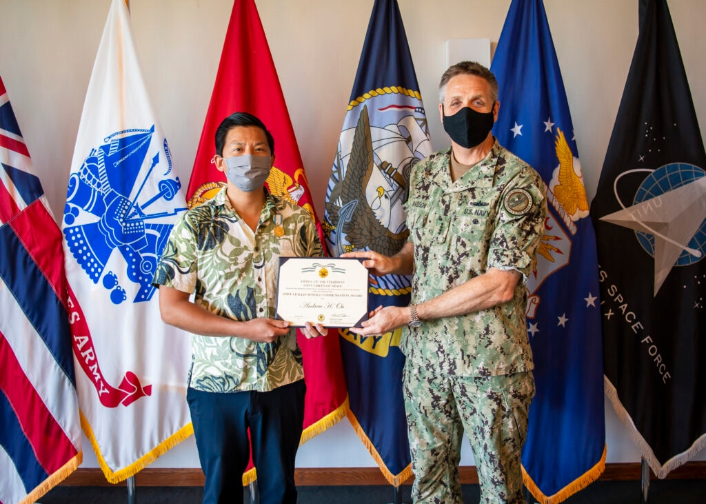 POLAD Andrew Ou receives the Joint Civilian Service Achievement Award. To the right is U.S. INDOPACOM Commander Admiral Philip S. Davidson. (State Department photo)