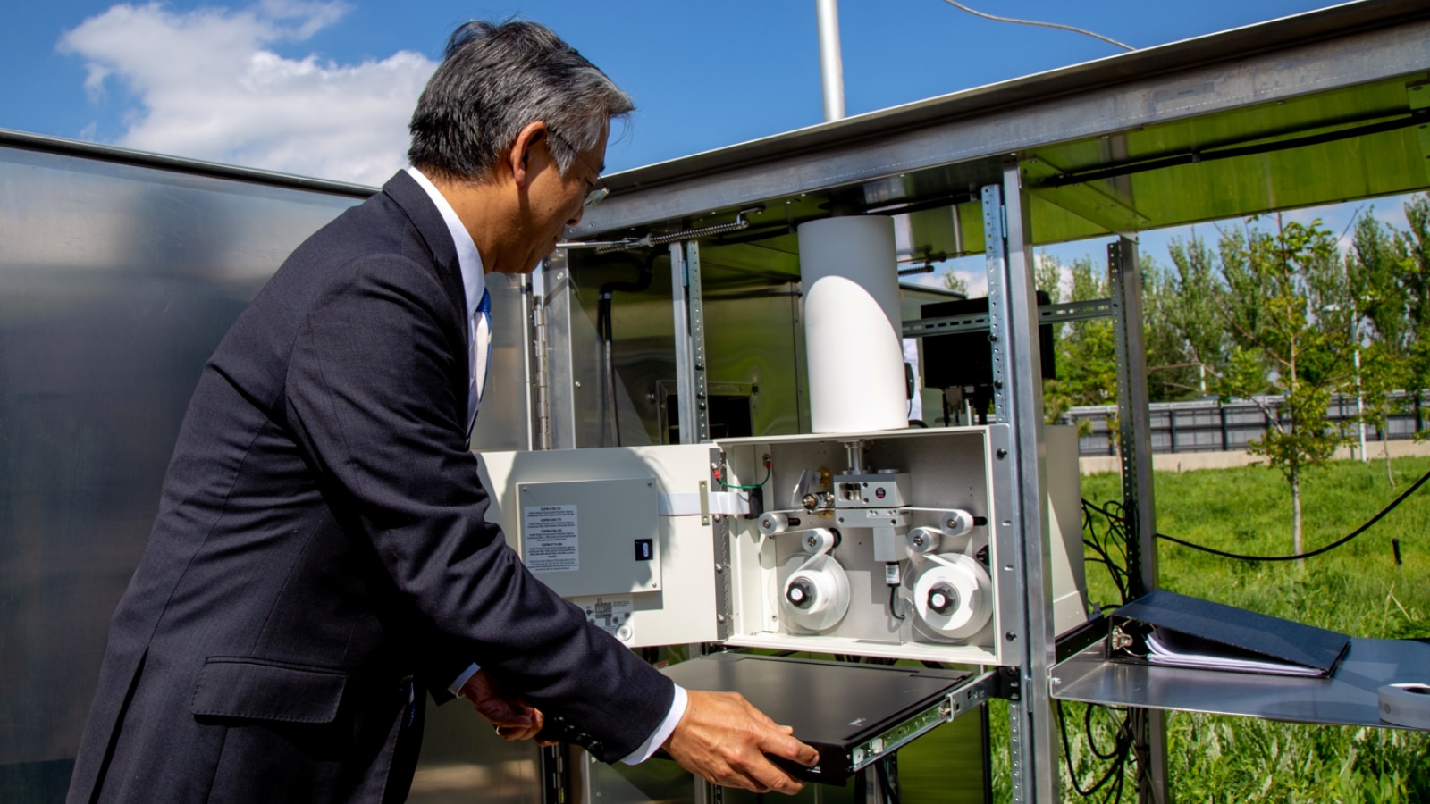 U.S. Ambassador to the Kyrgyz Republic Donald Lu examines the beta attenuation monitor at U.S. Embassy Bishkek. The monitor collects data on the particulate matter present in the air. (Courtesy of U.S. Embassy Bishkek)