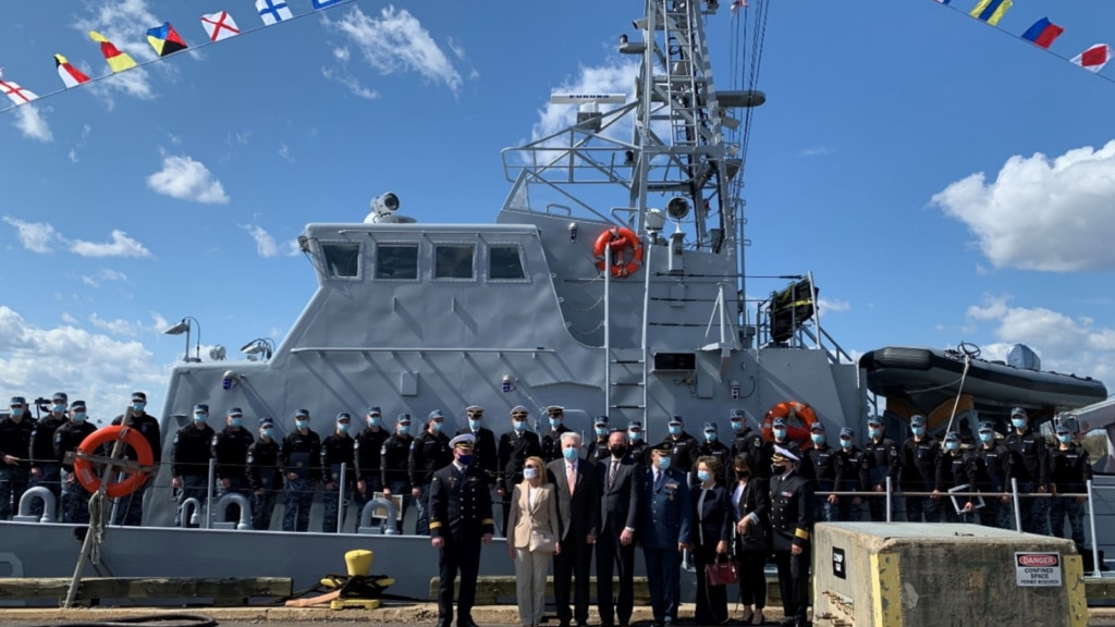Ukrainian naval personnel and their American trainers pose in front of Sumy on graduation day. (Photo courtesy of the U.S. Coast Guard)