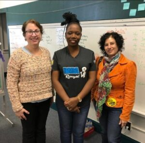 Angela Benedicto (center) takes a photo with Meg Blinkeiwicz, Executive Director, KYDNET (left) and Jodi Michaels, Executive Director, Global Ties Kalamazoo (right). (Photo courtesy of Angela Benedicto)