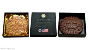 To celebrate Peru's Bicentennial and the disc's return, the U.S. Embassy in Lima shared specially-made, gold foil-wrapped chocolates bearing its design with key Peruvian contacts. [U.S. Embassy Lima photo]