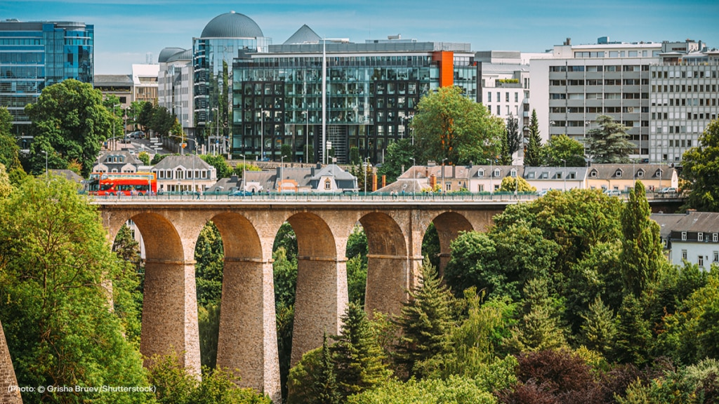 cityscape of Luxembourg with a bridge, buildings and train